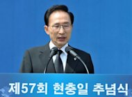 "South Korea's President Lee Myung-Bak makes a speech to mark the country's Memorial Day on June 6. South Korea accused North Korea of ""crossing the line"" with its recent threats and insults, and pressed the impoverished country to start repayments for past food aid"