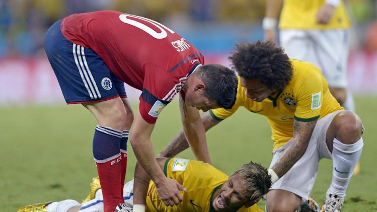 10ThingstoSeeSports - Brazil's Neymar screams out after being fouled during the World Cup quarterfinal soccer match between Brazil and Colombia at the Arena Castelao in Fortaleza, Brazil, Friday, July 4, 2014. (AP Photo/Manu Fernandez, File)