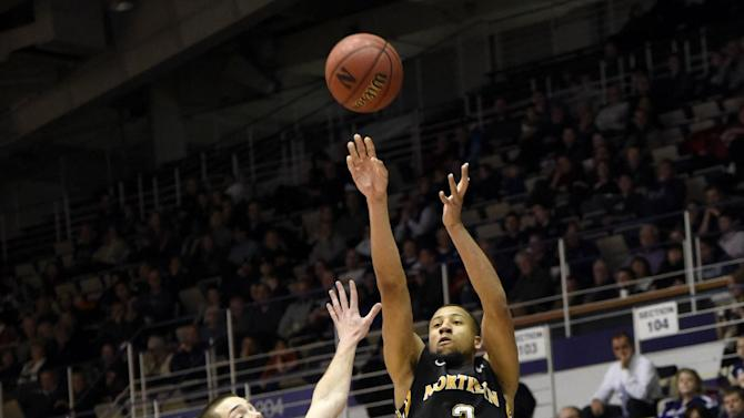 Northern Kentucky guard Tyler White (3) shoots over Northwestern guard Bryant McIntosh (30) during the first half of an NCAA basketball game in Evanston, Ill. Saturday, Dec. 27, 2014.  (AP Photo/David Banks)