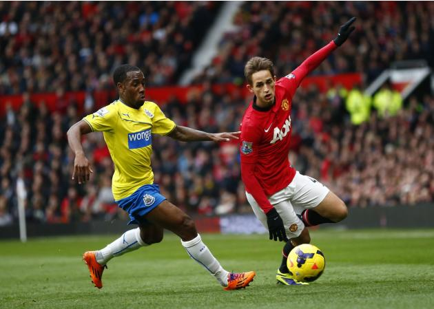 Manchester United's Januzaj challenges Newcastle United's Anita during their English Premier League soccer match at Old Trafford in Manchester