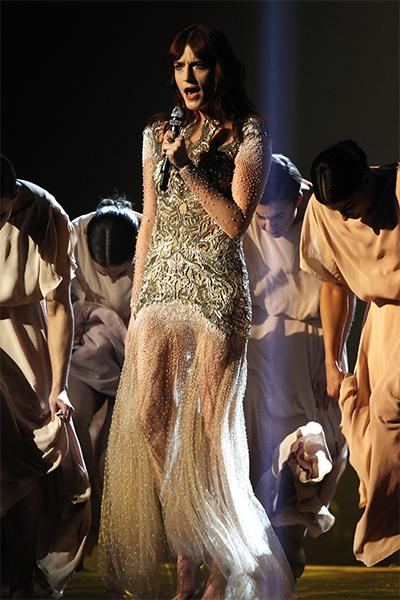 "Flo chose this McQueen dress to perform ""No Light, No Light"" at this year's Brit Awards. With its intricate embroidery and beadwork, the gown could easily take her from the red carpet to the stage, bu"