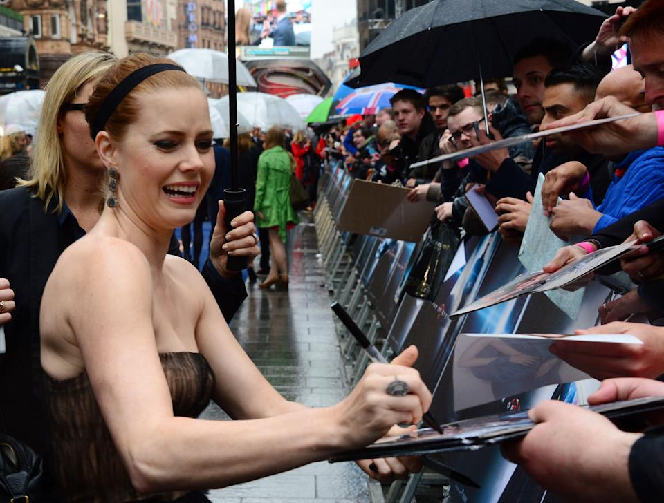 Actress Amy Adams signs autographs for fans aat the European Premiere of 'Man Of Steel' in London on Wednesday, June 12, 2013. (Photo by Jon Furniss/Invision/AP)