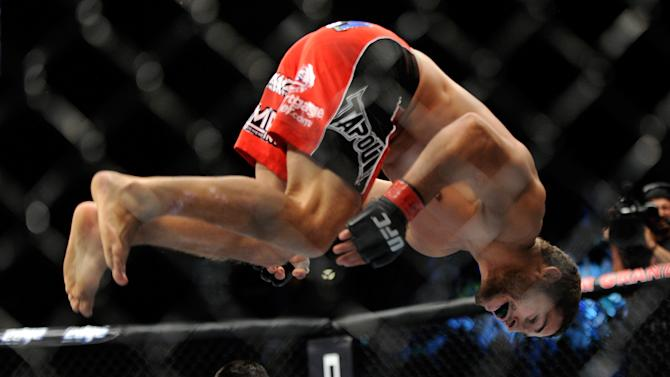 Chad Mendes, does a flip after winning his fight against Cody McKenzie by TKO during the first round of their UFC 148 featherweight bout at the MGM Grand Garden Arena, Saturday, July 7, 2012, in Las  Vegas. (AP Photo/David Becker)