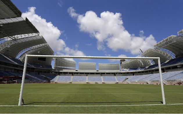 The empty goal stands in the Estadio das Dunas in Natal, Brazil, Friday, Dec. 13, 2013. Four matches of the 2014 soccer World Cup will be played in the stadium