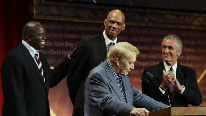 FILE - In this Aug. 13, 2010 file photo, Basketball Hall of Fame inductee, Los Angeles Lakers owner Jerry Buss, foreground, speaks as, from background left to right, Magic Johnson, Kareem Abdul Jabbar and Pat Riley react during the enshrinement ceremony in Springfield, Mass. Buss, the Lakers' playboy owner who shepherded the NBA franchise to 10 championships, has died. He was 79. Bob Steiner, an assistant to Buss, confirmed Monday, Feb. 18, 2013  that Buss had died in Los Angeles. Further details were not available. (AP Photo/Elise Amendola, File)
