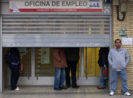 People wait for an unemployment registry office to open in Madrid Friday Jan. 27, 2012. The National Statistics Institute says Spain's unemployment figures has surpassed the 5 million mark, with the jobless rate shooting up from 21.5 percent to 22.8 percent in the fourth quarter. The new conservative Popular Party government pledges new labor reforms to try to halt further job destruction as Spain already has the highest unemployment rate in the 17-nation eurozone. (AP Photo/Paul White)