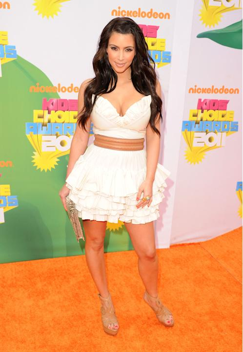 Kim Kardashian in a white mini