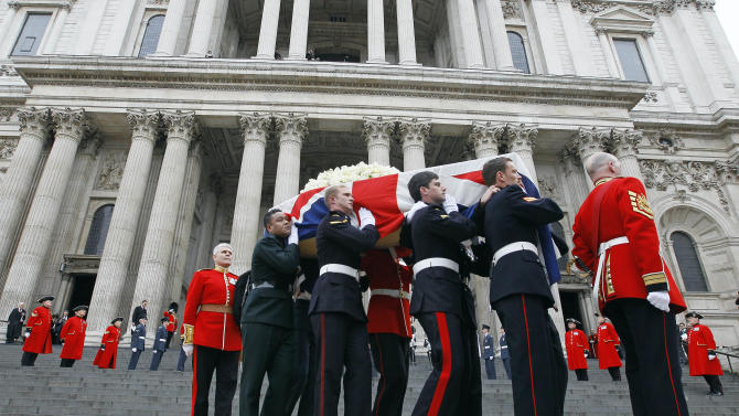 Former British Prime Minister Margaret Thatcher's coffin is carried by pallbearers out from St Paul's Cathedral, following the ceremonial funeral service in London, Wednesday, April 17, 2013. Thatcher, who died, at the age of 87 on 8 April, has been accorded a ceremonial funeral with military honours, one step down from a state funeral, Thatcher was elected Prime Minister on May 4, 1979 and she resigned on Nov. 28, 1990, after eleven years in office. (AP Photo/Alastair Grant)