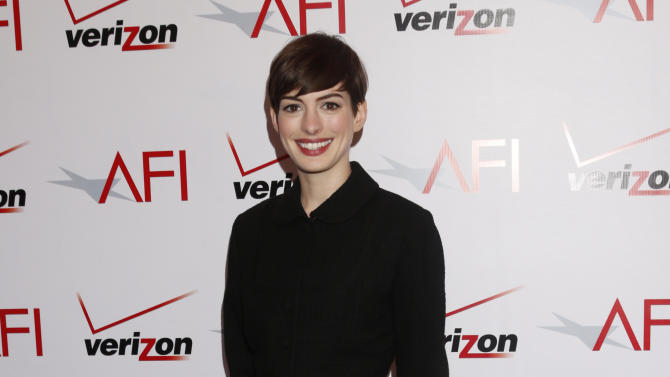 Anne Hathaway attends the 13th Annual AFI Awards Luncheon at the Four Seasons Hotel Los Angeles at Beverly Hills on Friday, January 11, 2013 in Los Angeles. (Photo by Todd Williamson/Invision/AP)