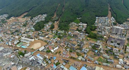 An aerial view shows several landslides that swept through a residential area at Asaminami ward in Hiroshima, western Japan