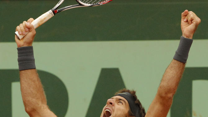 Argentina's Juan Martin del Potro reacts as he defeats Czech Republic's Tomas Berdych during their fourth round match in the French Open tennis tournament at the Roland Garros stadium in Paris, Monday, June 4, 2012. Del Potro won 7-6, 1-6, 7-3, 7-5. (AP Photo/Michel Spingler)