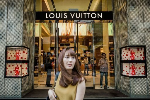 <p>A woman walks past a luxury shop in Hong Kong. Giving gifts is crucial if you want to get ahead in Chinese politics or business, but sales of luxury goods have slipped recently amid an economic slowdown and uncertainty over Beijing's once-a-decade leadership transition.</p>