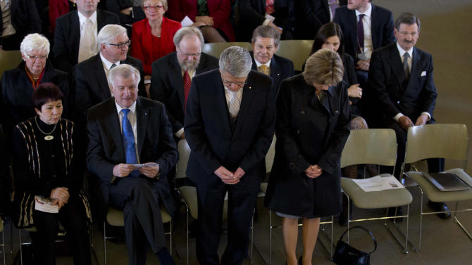 German presidential candidate Joachim Gauck, standing  2nd from left, and his partner Daniela Schadt, left, pray as they arrive at an ecumenical  service prior to a meeting of Federal Assembly  in Berlin, Sunday, March 18, 2012. The assembly convened solely for the purpose to elect the German President. (AP Photo/Markus Schreiber, Pool)