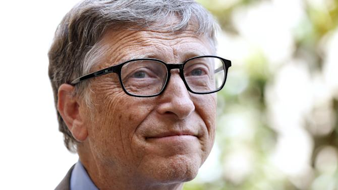 Bill Gates, co-cfounder of the Microsoft company and the Bill and Melinda Gates Foundation, leaves the Hotel Matignon after a meeting with the French Prime Minister in Paris, on June 27, 2014