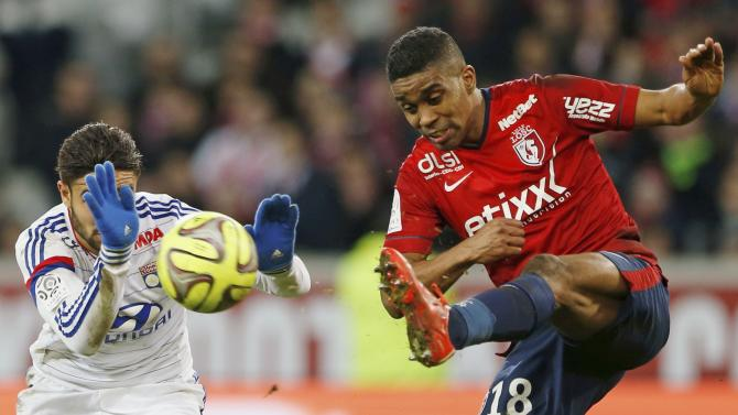 Lyon's Fekir challenges Lille's Beria during their French Ligue 1 soccer match at Pierre Mauroy stadium in Villeneuve d'Ascq near Lille