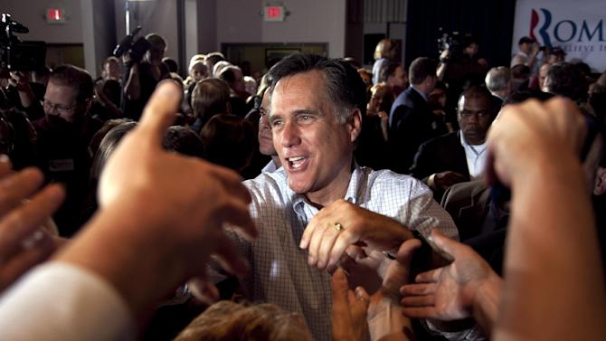 Republican presidential candidate, former Massachusetts Gov. Mitt Romney shakes hands with supporters during a campaign stop at an American Legion post in Arbutus, Md., Wednesday, March 21, 2012. (AP Photo/Steven Senne)