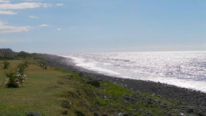 General view of the beach where a large piece of plane debris was found on Wednesday in Saint-Andre, on the French Indian Ocean island of La Reunion