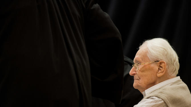 Defendant Oskar Groening sits on the dock of the court in Lueneburg, northern Germany, Tuesday, April 21, 2015. The  93-year-old former Auschwitz guard faces trial on 300,000 counts of accessory to murder, in a case that will test the argument that anyone who served at a Nazi death camp was complicit in what happened there. (Julian Stratenschulte/Pool Photo via AP)