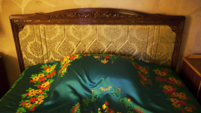 In this March 8, 2011 photo, a colorful, decorated sheet covers a bed inside the Koryo Hotel in Pyongyang, North Korea. (AP Photo/David Guttenfelder)