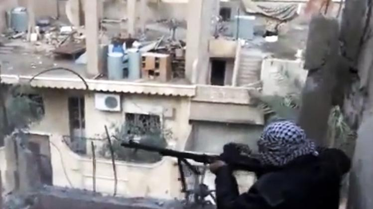 In this image taken from video obtained from the Shaam News Network, which has been authenticated based on its contents and other AP reporting, a Syrian rebel fires his weapon during clashes with government forces in Aleppo, Syria on Monday, Nov. 27, 2012. (AP Photo/Shaam News Network via AP video)