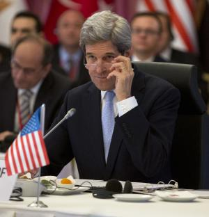 """U.S. Secretary of State John Kerry listens in during a """"Friends of Syria"""" group meeting hosted by Turkish Foreign Minister Ahmet Davutoglu at the Adile Sultan Palace on Saturday, April 20, 2013, in Istanbul, Turkey. Kerry is expected to announce a significant expansion of non-lethal aid to the Syrian opposition. (AP Photo/Evan Vucci, Pool)"""