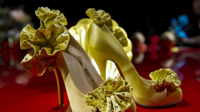 French shoe designer, Christian Louboutin, opens his first ever retrospective exhibition, at the Design Museum, London, Monday, April 30, 2012. The exhibition will be the first comprehensive presentation of Louboutin's work, and will showcase how he has helped transform the design of the shoe over the past 20 years. (AP Photo/Jonathan Short)