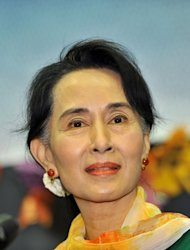 Myanmar&#39;s opposition leader Aung San Suu Kyi speaks during a meeting with Myanmar people living in South Korea, in Seoul on February 1, 2013. Archbishop Desmond Tutu said Tuesday he hoped to see a &quot;truly free&quot; Myanmar as he met fellow Nobel Peace Prize winner Aung San Suu Kyi during a visit to the former junta-ruled nation