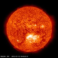 This image from the Solar Dynamics Observatory (SDO) shows the sun at 12:45 PM EDT on July 12, 2012 during an X1.4 class flare. The image is captured in the 304 Angstrom wavelength, which is typically colorized in red and shows temperatures in