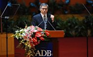 "Southeast Asian economies are forecast to grow by 5.2 percent in 2012, the chief of Asian Development Bank Haruhiko Kuroda, seen here in 2011, said though he urged nations to be ""vigilant"" in an uncertain global environment"
