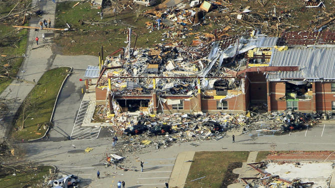 FILE - A March 3, 2012, file photo, shows the Henryville Jr./Sr. High School in Henryville, Ind., after a tornado swept through town. Grammy-winning Lady Antebellum is scheduled to perform Wednesday night, May 16, 2012, at the KFC Yum Center in Louisville, Ky., to raise money for rebuilding Henryville, Ind., about 20 miles to the north.  (AP Photo/Al Behrman, File)
