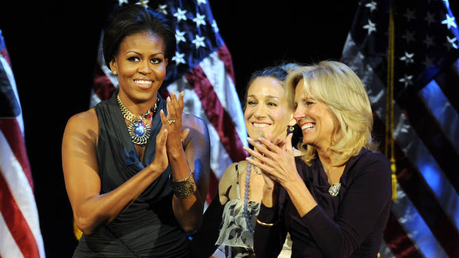 U.S. First Lady Michelle Obama, left, applauds with actress Sarah Jessica Parker, center, and Jill Biden after speaking at a Democratic National Committee fundraiser Monday Oct. 18, 2010 in New York. (AP Photo/Stephen Chernin)