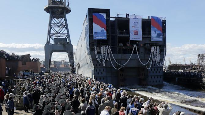 The stern of Sevastopol, a Mistral class, amphibious assault ship is launched at St.Petersburg naval shipyard on Wednesday, April 30, 2014. The stern is to be tugged to France, where where whole ship will be finished. The Russian acquisition of French Mistral class amphibious assault ships is considered to be the largest defense deal between Russia and the West since World War I. (AP Photo/Dmitry Lovetsky)