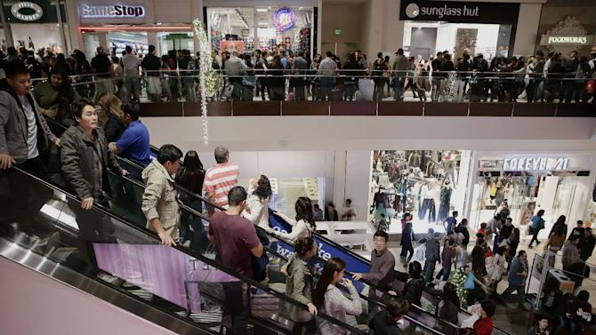 FILE - This Nov. 29, 2013 file photo shows shoppers in Brea Mall during Black Friday shopping in Brea, Calif. For President Barack Obama's entire presidency, pocketbook worries have been the dominant issue with Americans. But an uptick in growth and a downtick in unemployment give the president a stronger story line going into the 2014 congressional election year and provide Democrats with a counterpoint to Republican attacks on Obama's health care law. (AP Photo/Jae C. Hong, File)