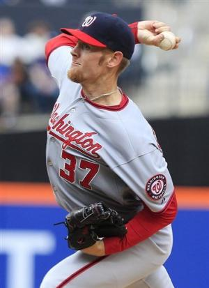 Strasburg outpitches Santana in messy matchup