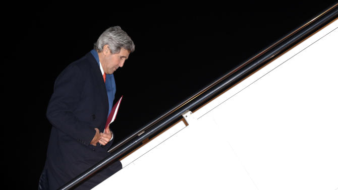 U.S. Secretary of State John Kerry departs Andrews Air Force Base, Md., en route to Ukraine, Monday, March 3, 2014. In remarks Monday, U.S. President Barack Obama said Kerry will propose ways in which a negotiation between Russia and Ukraine could be overseen by a multilateral organization when he goes to Kiev on Tuesday. (AP Photo/Kevin Lamarque, Pool)