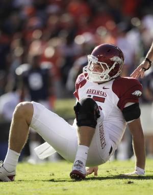 Arkansas quarterback Ryan Mallett (15) gets up slowly after being injured on a pass attempt in the first half of an NCAA college football game against Auburn in Auburn, Ala., Saturday, Oct. 16, 2010. (AP Photo/Dave Martin)