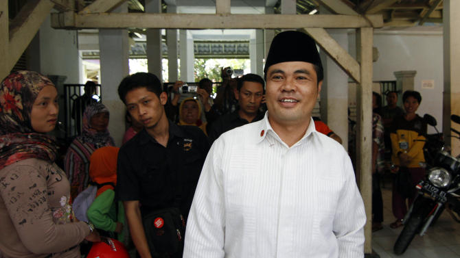 In this Friday, Feb. 1, 2013 photo, Garut District Chief Aceng Fikri walks through a hallway during his visit to a local hospital in Garut, West Java, Indonesia. The Supreme Court late last month recommended that the president dismiss Fikri for violating the marriage law, following a public outrage after he divorced his new teenage second wife by text message just four days after their wedding. The response has been seen as a small step forward for women's rights in the secular country where most people practice a moderate form of Islam. (AP Photo/Kusumadireza)