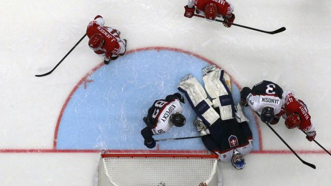 Slovakia's goaltender Laco reacts after a collision during their Ice Hockey World Championship game against Belarus at the CEZ arena in Ostrava