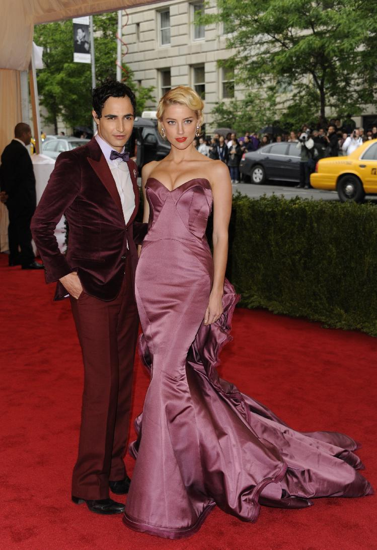Designer Zac Posen, left, and actress Amber Heard arrive at the Metropolitan Museum of Art Costume Institute gala benefit, celebrating Elsa Schiaparelli and Miuccia Prada, Monday, May 7, 2012 in New York. (AP Photo/Evan Agostini)