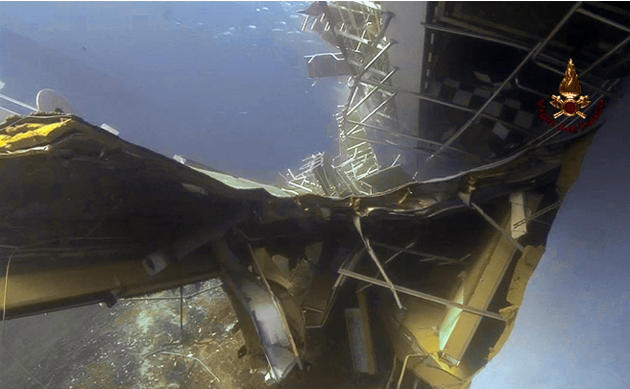 A frame grab taken from a video made available by Italian Firefighters Monday, Jan. 30, 2012, showing an underwater view of the cruise ship Costa Concordia grounded off the Tuscan island of Giglio, It