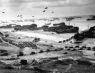 LSTs (Landing Ship Tanks), landing vehicles, and cargo are pictured on a Normandy beach in this June 1944 handout photo obtained by Reuters June 1, 2012. REUTERS/U.S. Navy/Handout