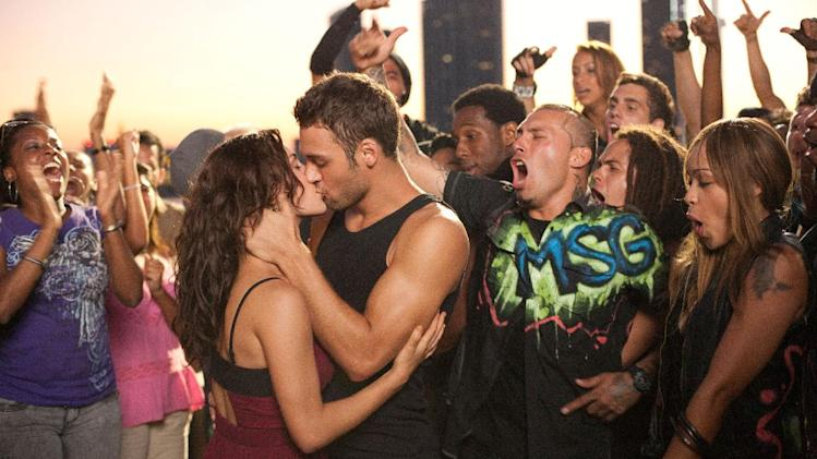"This film image released by Summit Entertainment shows Kathryn McCormick, left, and Ryan Guzman a scene from ""Step Up Revolution."" (AP Photo/Summit Entertainment, Sam Emerson)"