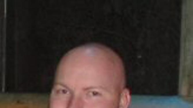 This undated file photo provided by the U.S. Air Force shows Jesse Childress. The 29-year-old, from Thornton, Colo., was one of the victims in the Friday, July 20, 2012 Aurora, Colo. movie theater shooting. A man who saved his girlfriend's life at the Colorado movie shooting was remembered for his selfless sacrifice Saturday, July 28, 2012 while an aspiring sportscaster was praised for her boundless energy and an Air Force reservist as a good friend.. (AP Photo/U.S. Air Force, File)