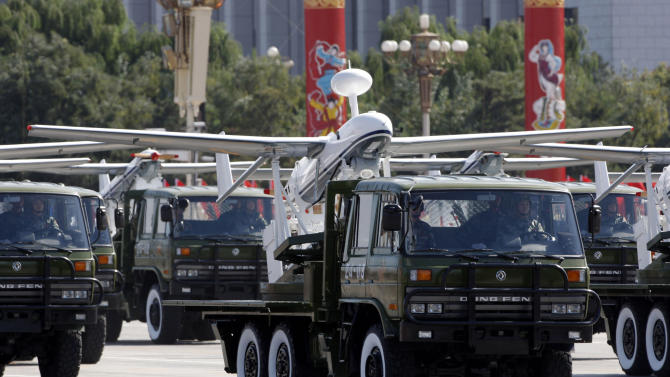 FILE - In this Oct. 1, 2009 file photo, a truck loaded with the Chinese made drone, the ASN-207, takes part in a military parade marking China's 60th anniversary held near Tiananmen Square in Beijing. Chinese aerospace firms developed dozens of drones, known also as unmanned aerial vehicles, or UAVs. Many have appeared at air shows and military parades, including some that bear an uncanny resemblance to the Predator, Global Hawk and Reaper models used with deadly effect by the U.S. Air Force and CIA. Analysts say that although China still trails the U.S. and Israel, the industry leaders, its technology is maturing rapidly and on the cusp of widespread use for surveillance and combat strikes. (AP Photo/Vincent Thian, File)
