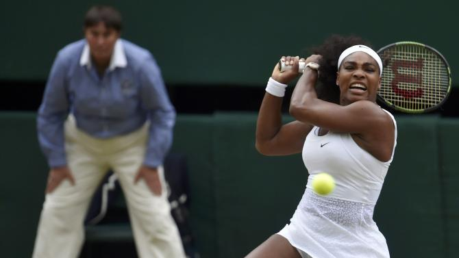 Serena Williams of the U.S.A. hits a shot during her match against Victoria Azarenka of Belarus at the Wimbledon Tennis Championships in London