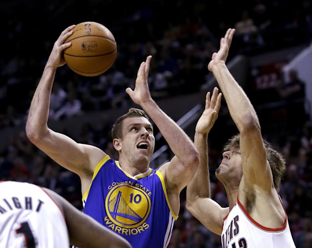 Golden State Warriors forward David Lee, left, drives to the hoop against Portland Trail Blazers center Robin Lopez during the first half of an NBA basketball game in Portland, Ore., Sunday, March 16,
