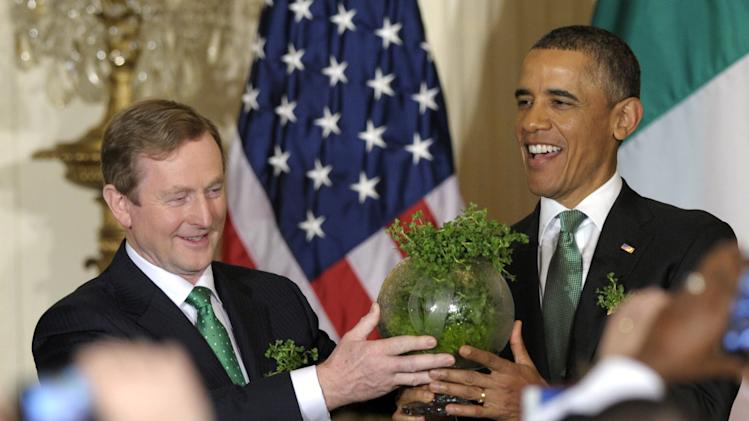 President Barack Obama and Irish Prime Minister Enda Kenny hold up a bowl of Irish shamrocks during a St. Patrickís Day reception in the East Room of the White House in Washington, Tuesday, March 19, 2013. (AP Photo/Susan Walsh)