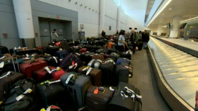 Luggage piles up at Pearson Airport in Toronto where weather caused major delays and flight cancellations on Tuesday and Wednesday.