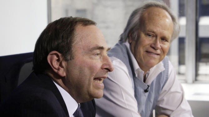 NHL commissioner Gary Bettman, left, and NBC Sports Group Chairman Dick Ebersol address a news conference at the offices of the National Hockey League, in New York, Tuesday, April 19, 2011. The NHL is staying on NBC and Versus for the next 10 years with a deal Commissioner Gary Bettman calls the most significant in league history.(AP Photo/Richard Drew)