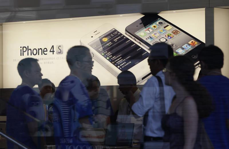 Customers are seen at an Apple store in Beijing